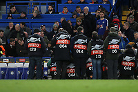 Photographers gather round the Chelsea dugout ahead of kick-off waiting for Manager, Maurizio Sarri to take his seat during Chelsea vs Dynamo Kiev, UEFA Europa League Football at Stamford Bridge on 7th March 2019