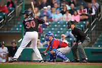 Rochester Red Wings Anthony Recker (30), Toronto Blue Jays catcher Luke Maile (52), on rehab assignment with the Buffalo Bisons, and umpire Chris Graham await the pitch during a game on August 25, 2017 at Frontier Field in Rochester, New York.  Buffalo defeated Rochester 2-1 in eleven innings.  (Mike Janes/Four Seam Images)