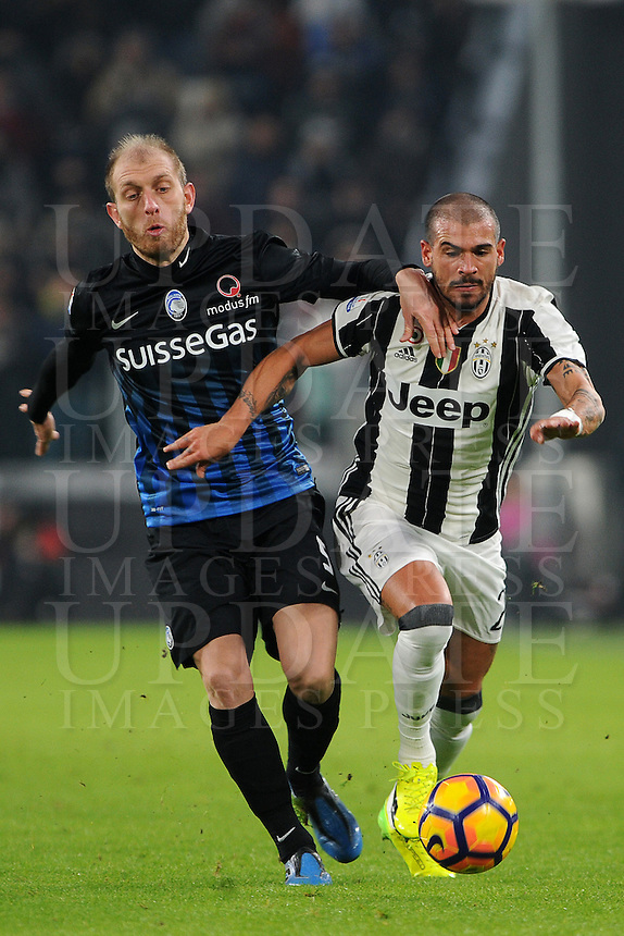Calcio, Ottavi di finale di Tim Cup: Juventus vs Atalanta. Torino, Juventus Stadium, 11 gennaio 2017.<br /> Juventus' Stefano Sturaro, right, is challenged by Atalanta's Andrea Masiello during the Italian Cup football round of 16 match between Juventus and Atalanta at Turin's Juventus Stadium, 8 January 2017. Juventus won 3-2 to join the quarter finals.<br /> UPDATE IMAGES PRESS/Manuela Viganti