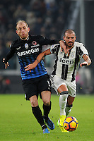 Calcio, Ottavi di finale di Tim Cup: Juventus vs Atalanta. Torino, Juventus Stadium, 11 gennaio 2017.<br /> Juventus&rsquo; Stefano Sturaro, right, is challenged by Atalanta's Andrea Masiello during the Italian Cup football round of 16 match between Juventus and Atalanta at Turin's Juventus Stadium, 8 January 2017. Juventus won 3-2 to join the quarter finals.<br /> UPDATE IMAGES PRESS/Manuela Viganti