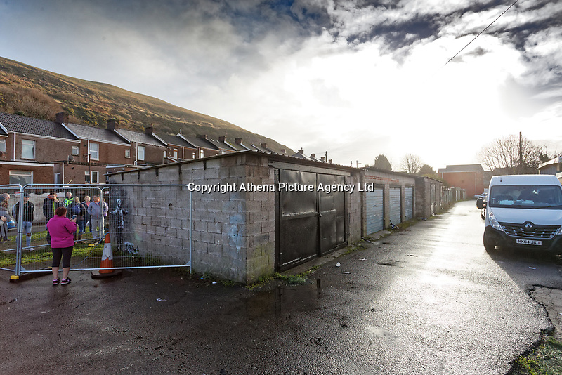 "Pictured: The front side of the garage where the Banksy graffiti is painted on in Port Talbot, Wales, UK. Thursday 20 December 2018<br /> Re: The artist Banksy has confirmed that a new graffiti piece that has appeared in Port Talbot, south Wales is his.<br /> He announced on Instagram: ""Season's greetings"" - with a video of the artwork in the Taibach area of Port Talbot.<br /> The image appears on two sides of a garage in a lane near Caradog Street, depicting a child enjoying snow falling - the other side reveals it is a fire emitting ash.<br /> The owner of the garage said he had not slept over fears it might be vandalised."