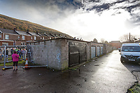 Pictured: The front side of the garage where the Banksy graffiti is painted on in Port Talbot, Wales, UK. Thursday 20 December 2018<br /> Re: The artist Banksy has confirmed that a new graffiti piece that has appeared in Port Talbot, south Wales is his.<br /> He announced on Instagram: &quot;Season's greetings&quot; - with a video of the artwork in the Taibach area of Port Talbot.<br /> The image appears on two sides of a garage in a lane near Caradog Street, depicting a child enjoying snow falling - the other side reveals it is a fire emitting ash.<br /> The owner of the garage said he had not slept over fears it might be vandalised.