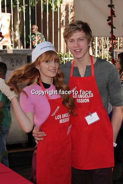 LOS ANGELES, CA - December 24: Bella Thorne, Tristan Klier at The Los Angeles Mission Christmas Eve Celebration, Los Angeles Mission, Los Angeles, December 24, 2013. .<br />