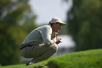 Straffin Co Kildare Ireland. K Club Ruder Cup...European Ryder Cup team member Padraig Harrington lines up his putt on 16th green on the opening fourball session on the first day of the 2006 Ryder Cup, at the K Club in Straffan, Co Kildare, in the Republic of Ireland, 22 September 2006..Photo: Eoin Clarke/ Newsfile..