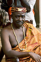 Village chief draped in  hand-woven ceremonial Kente cloth garment in Ghana, Africa.