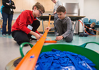 NWA Democrat-Gazette/BEN GOFF @NWABENGOFF<br /> Campers explore science with Hot Wheels cars Wednesday, March, 21, 2018, during the &quot;Wheels, Wings &amp; Motorized Things&quot; Spring Break camp at the Scott Family Amazeum in Bentonville. The camp, inspired by the museum's temporary exhibit Hot Wheels: Race to Win, gives campers hands on opportunities to explore elements of physics such as gravity, friction and momentum.