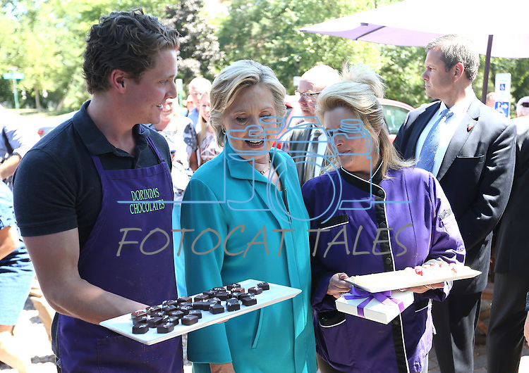 Dorinda's Chocolate's workers offer candy to Democratic presidential nominee Hillary Clinton during a campaign stop in Reno, Nev., on Thursday, Aug. 25, 2016. Cathleen Allison/Las Vegas Review-Journal