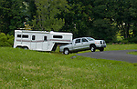 Dodge RAM truck towing horse trailer
