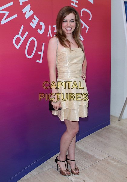"MOLLY BURNETT .""Days Of Our Lives"" Executive Producer Ken Corday Book Launch Party  held at  The Paley Center For Media, Beverly Hills,California, USA, 29th April 2010..full length gold dress tiered smiling t-bar shoes sandals .CAP/ADM/TC.©T. Conrad/AdMedia/Capital Pictures."