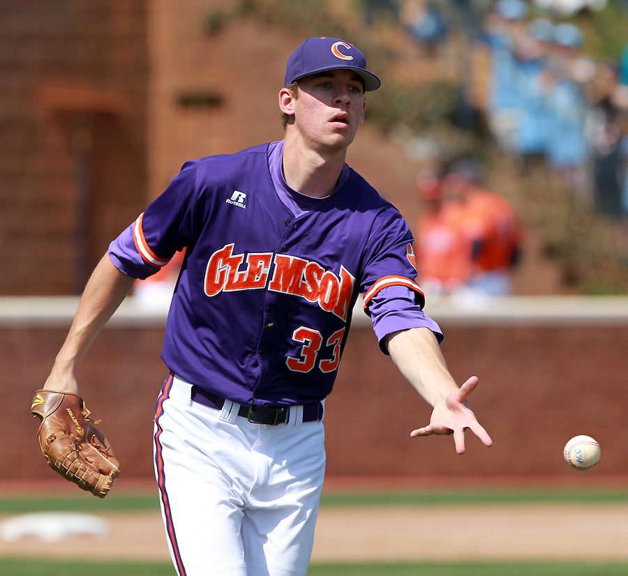 Clemson pitcher Zack Erwin (33) throws to first base during the game against Virginia Sunday at Davenport Field in Charlottesville, VA. Photo/Daily Progress/Andrew Shurtleff