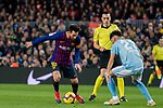 Lionel Andres Messi of FC Barcelona (L) is tackled by Jozabed Sanchez Ruiz of RC Celta de Vigo during the La Liga 2018-19 match between FC Barcelona and RC Celta de Vigo at Camp Nou on 22 December 2018 in Barcelona, Spain. Photo by Vicens Gimenez / Power Sport Images