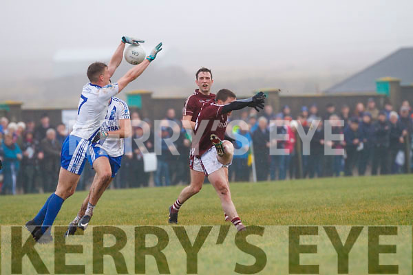 St Marys Denis Daly keeps his eye on the ball as he blocks down this shot which was surely going to be a point for Dromids Niall Ó Sé.