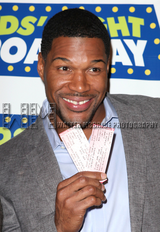Michael Strahan attending the Kids' Night on Broadway ticket launch with National Ambassadors Kelly Ripa & Michael Strahan at the August Wilson Theatre in New York City on 1/9/2013
