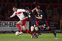 Marcus Haber of Stevenage tangles with Josh Simpson (r) and Joe Walsh of Crawley.Stevenage v Crawley Town - npower League 1 -  Lamex Stadium, Stevenage - 15th December, 2012. © Kevin Coleman 2012..