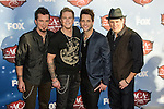 Barry Knox, Josh McSwain, Matt Thomas, Scott Thomas, of Parmalee arrives at the American Country Awards 2013 at the Mandalay Bay Resort & Casino in Las Vegas, Nevada