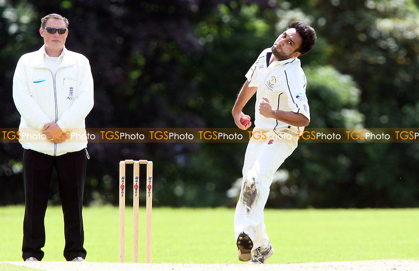 Ricky Gill of Ardleigh Green in bowling aciton - Ardleigh Green Cricket Club vs Ilford Cricket Club, Essex Club Cricket at Central Park, Ardleigh Green - 30/06/12 - MANDATORY CREDIT: Rob Newell/TGSPHOTO - Self billing applies where appropriate - 0845 094 6026 - contact@tgsphoto.co.uk - NO UNPAID USE..