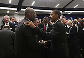 Washington, DC - December 3, 2009 -- United States President Barack Obama shakes hands with an unidentified business leader at the closing session of the White House Jobs and Economic Growth Summit on Thursday, December 3, 2009. .Credit: Dennis Brack / Pool via CNP