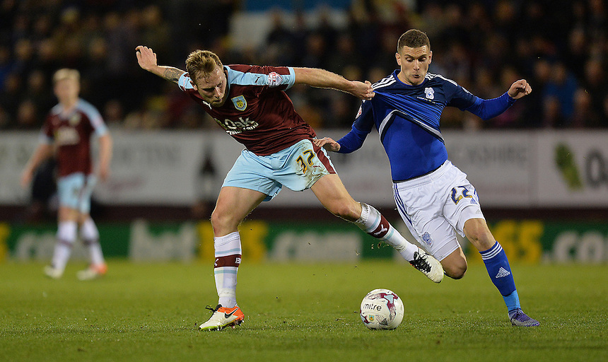 Burnley's Scott Arfield battles with Cardiff City's Stuart O'Keefe<br /> <br /> Photographer Dave Howarth/CameraSport<br /> <br /> Football - The Football League Sky Bet Championship - Burnley v Cardiff City  - Tuesday 5th April 2016 - Turf Moor - Burnley <br /> <br /> &copy; CameraSport - 43 Linden Ave. Countesthorpe. Leicester. England. LE8 5PG - Tel: +44 (0) 116 277 4147 - admin@camerasport.com - www.camerasport.com
