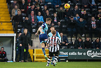 Dominic Gape of Wycombe Wanderers clears during the Sky Bet League 2 match between Notts County and Wycombe Wanderers at Meadow Lane, Nottingham, England on 10 December 2016. Photo by Andy Rowland.