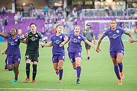 Orlando, FL - Sunday May 14, 2017: Orlando Pride celebrate their win. Ashlyn Harris, Steph Catley, Maddy Evans, Toni Pressley. during a regular season National Women's Soccer League (NWSL) match between the Orlando Pride and the North Carolina Courage at Orlando City Stadium.