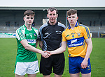 Limerick captain John Hayes and  Clare captain Cillian Rouine with referee Pa O Driscoll before their Munster Minor football quarter final at  Cusack Park. Photograph by John Kelly.
