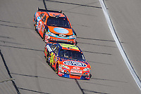 Sept. 28, 2008; Kansas City, KS, USA; Nascar Sprint Cup Series driver Jeff Gordon leads Jeff Burton during the Camping World RV 400 at Kansas Speedway. Mandatory Credit: Mark J. Rebilas-