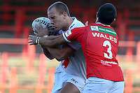 PICTURE BY ALEX WHITEHEAD/SWPIX.COM - Rugby League - Autumn International Series - Wales vs England - Glyndwr University Racecourse Stadium, Wrexham, Wales - 27/10/12 - England's Lee Mossop is tackled by Wales' Mike Channing.