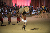 Xavante warriors participate in the Log Race, carrying a very heavy palm tree log, at the International Indigenous Games, in the city of Palmas, Tocantins State, Brazil. Photo © Sue Cunningham, pictures@scphotographic.com 24th October 2015