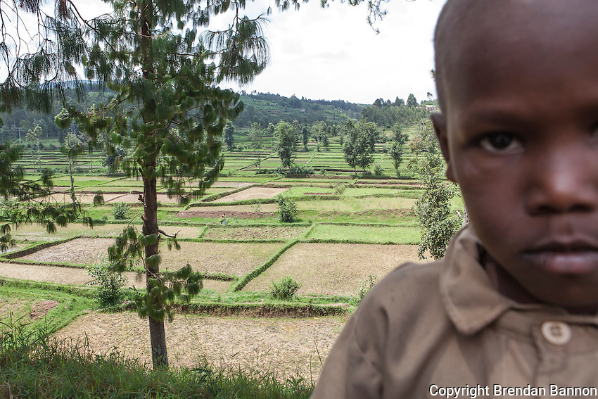 """Rice is my favorite food, but when I'm grown I'll be  a soldier. Farmers don't get much money and with a soldier's pay I can buy all the rice I want."" -Simon Majyambere on the road to Butare above a rice paddy. Photo by Brendan Bannon Rwanda, Feb. 27, 2014."