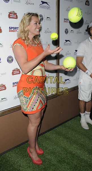 Chimene &quot;Chemmy&quot; Mary Alcott<br /> attended the Slazenger Wimbledon Party, Whisky Mist bar &amp; nightclub, Hertford St., London, England, UK, 27th June 2013.<br /> full length orange dress print shoes coral tennis ball side juggling balls yellow <br /> CAP/CAN<br /> &copy;Can Nguyen/Capital Pictures