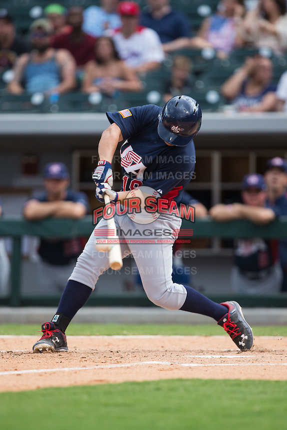 Matt Thaiss (19) of the US Collegiate National Team makes contact with the baseball against the Cuban National Team at BB&T BallPark on July 4, 2015 in Charlotte, North Carolina.  The United State Collegiate National Team defeated the Cuban National Team 11-1.  (Brian Westerholt/Four Seam Images)