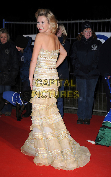 AMANDA HOLDEN .Collars and Coats Gala marking Battersea Dogs & Cats Home's 150th Anniversary at Battersea Power Station, Battersea, London, England, UK, November 25th 2010..full length back over shoulder looking rear behind  strapless gold  white beige cream white long maxi gown fishtail dress hand on hip.CAP/WIZ.© Wizard/Capital Pictures.