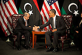 United States President Barack Obama, right, shakes hands with Chairman Mustafa Abdel Jalil of the Libyan Transitional National Council (TNC), left, at the United Nations in New York, New York on Tuesday, September 20, 2011..Credit: Allan Tannenbaum / Pool via CNP