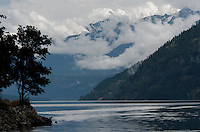 View down Lake Chelan, with clouds and mist brushing mountainsides, Stehekin, North Cascades National Park, Washington State