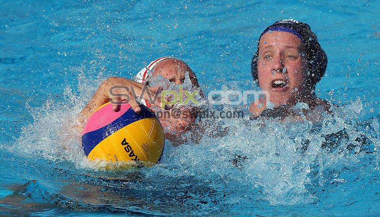 PICTURE BY VAUGHN RIDLEY/SWPIX.COM - Water Polo - 15th FINA World Championships 2013 - Great Britain v Canada - Bernat Picornell Swimming Pool, Barcelona, Spain - 21/07/13 - Great Britain's Chloe Wilcox and Canada's Katrina Monton battle for a loose ball.
