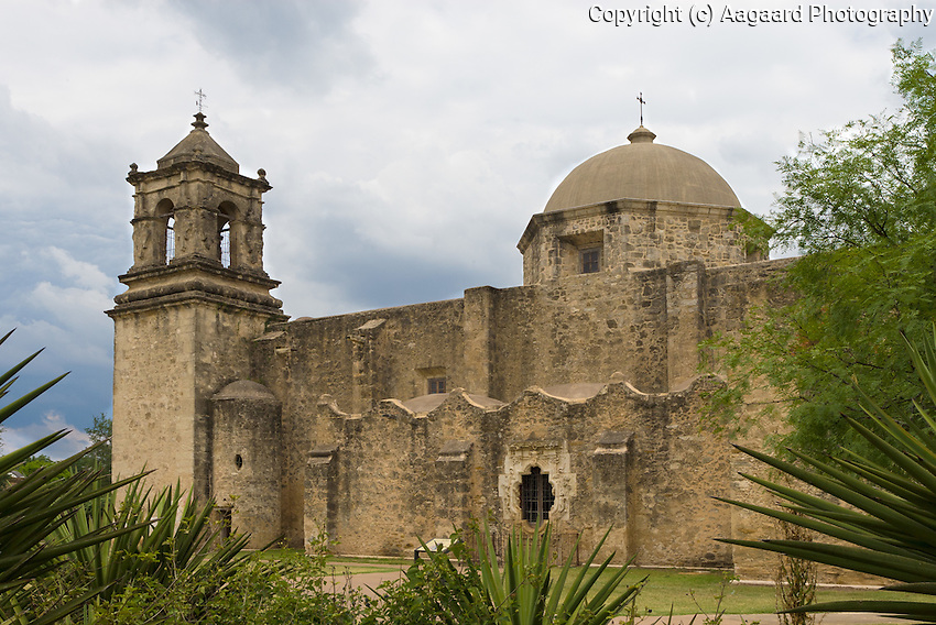 Mission San Jose, San Antonio, Texas.  The ornate Rose Window is clearly visible.  I chose this low angle partly to hide the large informational sign in front of it.<br /> <br /> Canon EOS 30D, 17-40 f/4L lens