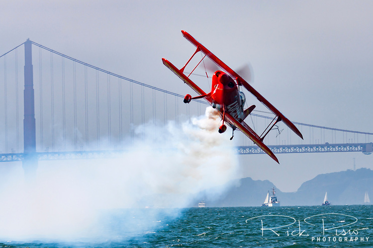 Michael Wiskus pilots the Lucas Oil S-1-11b SS Modified Pitts biplane during an aerobatic performance as part of the 2009 San Francisco Fleet Week Airshow over San Francisco Bay.