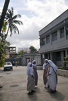 Nuns of Missionaries of Charity Prem dan - a home for physically and mentally challenged run by the missionaries of Charity, Kolkata, West Bengal, India. 21st August 2010. Arindam Mukherjee. Missionaries of Charity was founded by Mother Teresa