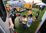 Carson City Fire Department Firefighter/Paramedic Riches talks with a group of kids at the 11th annual National Night Out hosted by the Carson City Sheriff's Office in Carson City, Nev., on Tuesday, Aug. 6, 2013. <br /> Photo by Cathleen Allison