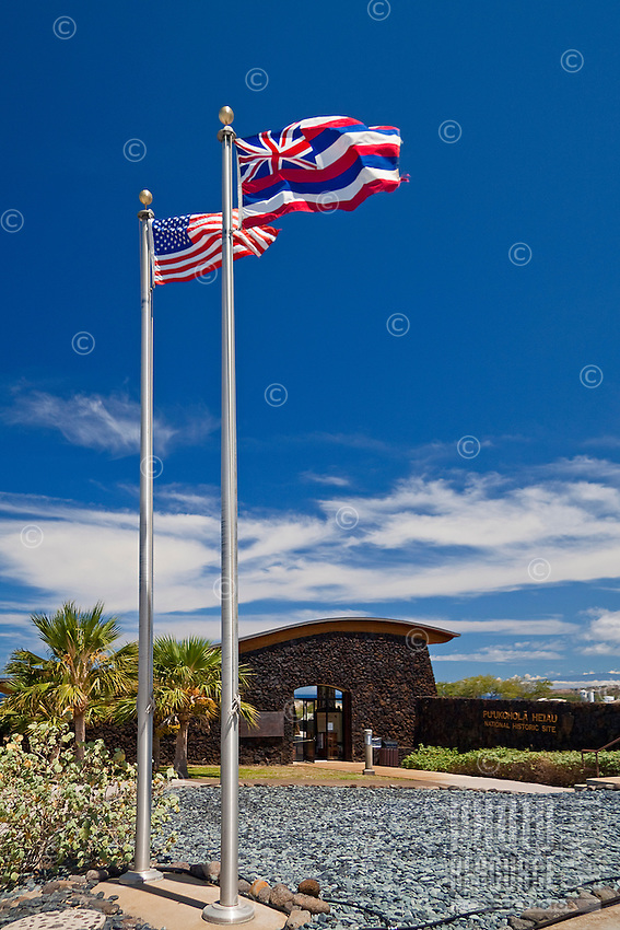 The American and Hawaiian flags at the entrance of Pu'ukohola Heiau National Historic Site's visitor center, Kawaihae, Kohala, Big Island.