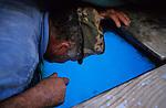 ITALY, Sicily, Egedian island Favignana, La Mattanza, traditional fishing of bluefin Tuna fish, watching for the Tuna through a glass in the boat