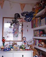 In a contemporary London house bunting adds a cheery note to this bright child's bedroom