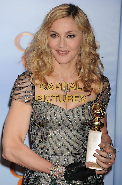 Madonna (wearing Reem Acra).Press Room at the 69th Annual Golden Globe Awards held at the Beverly Hilton Hotel, Hollywood, California, USA..January 15th, 2012.globes half length silver dress award trophy winner gown glove cross crucifix necklace  cleavage .CAP/GDG.©GDG/Capital Pictures