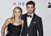 LOS ANGELES, CA - FEBRUARY 08: Christina Perri (L) and Paul Costabile attend MusiCares Person of the Year honoring Dolly Parton at Los Angeles Convention Center on February 8, 2019 in Los Angeles, California.<br /> CAP/ROT/TM<br /> &copy;TM/ROT/Capital Pictures
