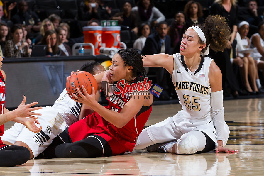 Mariya Moore (4) of the Louisville Cardinals fights for a loose ball with Dearica Hamby (25) of the Wake Forest Demon Deacons during second half action at the LJVM Coliseum on January 11, 2015 in Winston-Salem, North Carolina.  The Cardinals defeated the Demon Deacons 79-68.  (Brian Westerholt/Sports On Film)