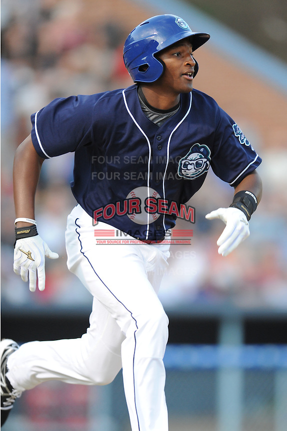 Asheville Tourists first baseman Correlle Prime #32 runs to first during opening night game against the Delmarva Shorebirds at McCormick Field on April 3, 2014 in Asheville, North Carolina. The Tourists defeated the Shorebirds 8-3. (Tony Farlow/Four Seam Images)