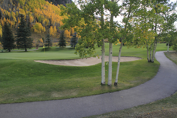 Pathway and golf green at Vail Golf Course, Vail Colorado, USA.