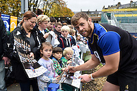 Dave Attwood of Bath Rugby mingles and signs autographs with supporters at the end of the session. Bath Rugby Captain's Run on October 30, 2015 at the Recreation Ground in Bath, England. Photo by: Patrick Khachfe / Onside Images
