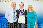 Justin Duggan from Tralee who graduated from I T Tralee on Friday, with a Batchelor of Arts in Social Care stands with mom and dad, John and Kathy Duggan