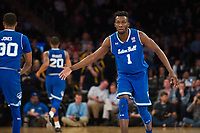 NEW YORK, NY - Thursday March 9, 2017: Michael Nzei (#1) of Seton Hall and Madison Jones (#30) of Seton Hall high-five as they lead Marquette in the second half in the Quarterfinals of the Big East Tournament at Madison Square Garden.